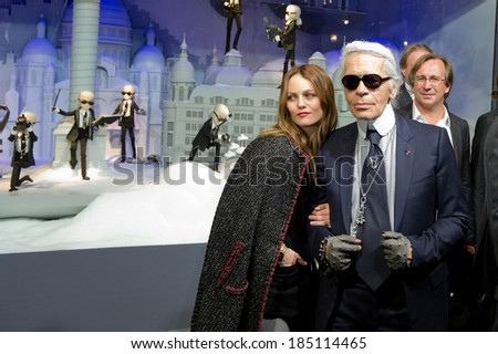 PARIS, FRANCE - NOVEMBER 9, 2011 - Vanessa Paradis and Karl Lagerfeld during the light period of Paris for Christmas. They inaugurated the store windows of the department store Printemps Haussmann. - stock photo