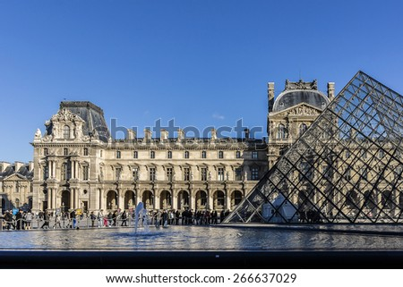 PARIS, FRANCE - NOVEMBER 12, 2014: View of Louvre building at courtyard of Louvre Museum. Louvre Museum is one of the largest and most visited museums worldwide. - stock photo