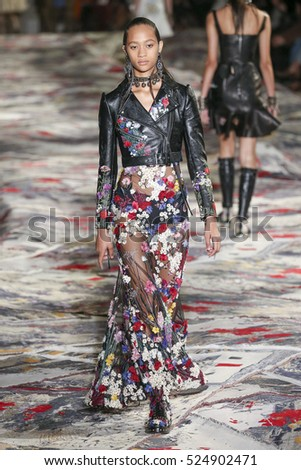PARIS, FRANCE - OCTOBER 3: A model walks the runway during the Alexander McQueen designed by Sarah Burton show as part of the Paris FW Womenswear Spring/Summer 2017 on October 3, 2016 in Paris, France