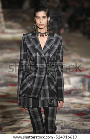 PARIS, FRANCE - OCTOBER 3: A model walks the runway during the Alexander McQueen designed by Sarah Burton show as part of the Paris Fashion Week  Spring/Summer 2017 on October 3, 2016 in Paris, France