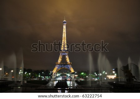 PARIS, FRANCE - OCTOBER 5: Eiffel tower at night. The Eiffel tower is the most visited monument of France and the stroboscope starts at fixed hours and lasts 5 minutes. October 5, 2010 in Paris - stock photo