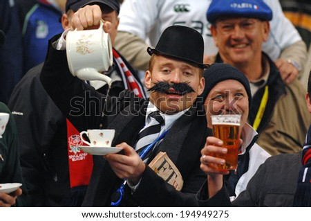 PARIS, FRANCE-OCTOBER 21, 2007:  english rugby fans serving tea for fun, during the final England vs South Africa, of the Rugby World Cup, France 2007, in Paris - stock photo