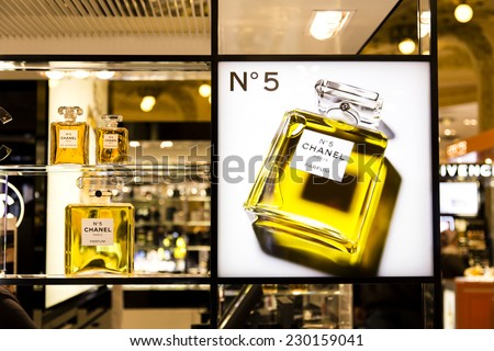 PARIS, FRANCE - OCTOBER 17 : Famous luxury Chanel N�°5 perfume in the Parisian upmarket Galeries Lafayettes on October 17th, 2013 in Paris, France - stock photo