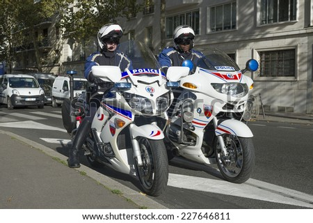 PARIS, FRANCE - OCTOBER 31, 2014 :French policeman on their motorbikes ready to catch driver in excess speed - stock photo