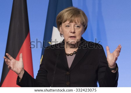 PARIS, FRANCE - OCTOBER 27, 2015 : German Chancellor Angela Merkel at the Elysee Palace for a digital conference in the context of European Round Table of Industrialist. - stock photo