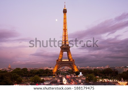 PARIS, FRANCE - OCTOBER 7: Illuminated  Eiffel tower on October 7, 2011. Sunset and the moon and the famous Paris landmark viewpoint - stock photo