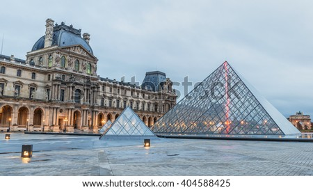 Paris, France - October 17, 2014: Louvre museum at twilight, The Louvre museum is one of the largest and most visited museums worldwide