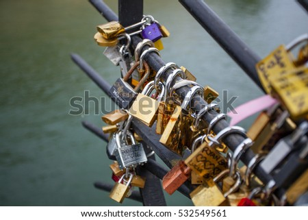 PARIS, FRANCE -OCTOBER 1, 2016: Love Padlocks at Pont de l'Archevche in Paris. The thousands of locks of loving couples symbolize love forever.