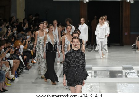 PARIS, FRANCE - OCTOBER 02: Models walk the runway finale during the Chalayan show as part of the Paris Fashion Week Womenswear Spring/Summer 2016 on October 2, 2015 in Paris, France. - stock photo