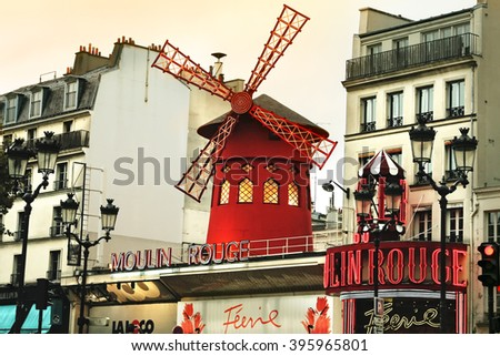 PARIS, FRANCE - OCTOBER 05, 2008: Moulin Rouge and street view in Paris. It is the most-visited paid monument in the world with annual 250M visitors.