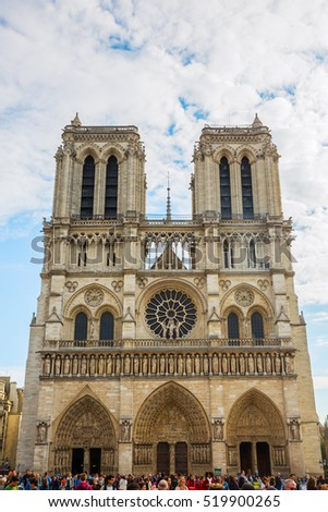 Paris, France - October 16, 2016: Notre Dame de Paris with unidentified people. The cathedral is among the largest and most well-known church buildings in the world and a landmark of Paris