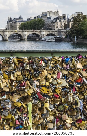 Paris, France - October 02, 2014: Padlocks at Passarelle des Arts Bridge that symbolize the desire for an eternal love. Over 16000 lockers have been left by couples in love on Passarelle des Arts. - stock photo
