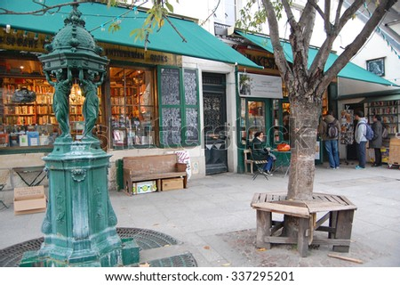 Paris, France - October 30, 2012: people outside the famous Shakespeare bookstore in Paris, France. Opened by George Whitman in 1951, the bookshop is a popular tourist attraction.  - stock photo