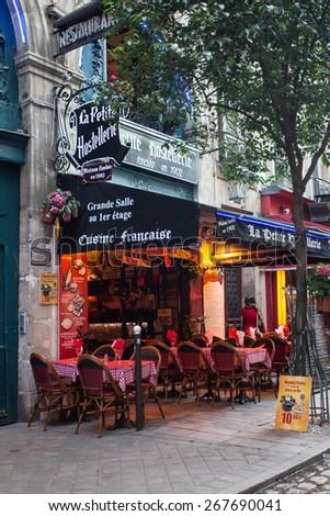PARIS, FRANCE - OCTOBER 9, 2014: Quaint restaurant scene from the Latin Quarter on the left bank of Paris France  - stock photo