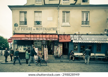 PARIS, FRANCE - OCTOBER 9, 2014:  Street scene in historic Montmartre district in Paris with vintage filter effect. - stock photo