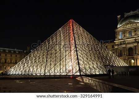 Paris, France-October 18, 2015: The Louvre Pyramid based in  the main courtyard( Cour Napoleon) of the Louvre Palace in Paris, France.It serves as the main entrance to the Louvre Museum. - stock photo