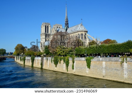 PARIS, FRANCE - OCTOBER 12: The Notre Dame cathedral of Paris, France, on october 12, 2014, one of the most famous landmarks in Paris. In 2013, the cathedral celebrate its 850 years anniversary.  - stock photo