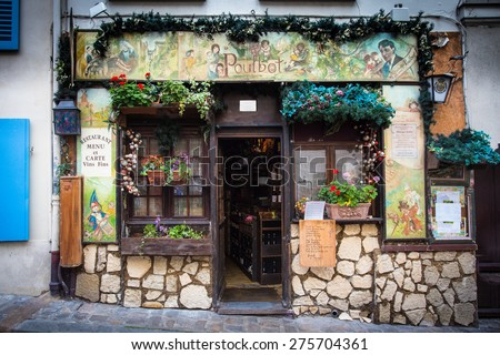 PARIS, FRANCE - OCTOBER 9, 2014:  Tourism point of interest  een from street in Montmartre Paris, France of charming cafe. - stock photo