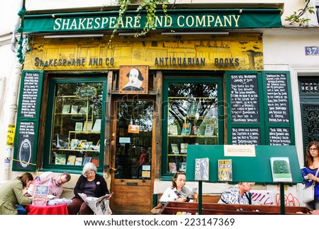 PARIS, FRANCE - OCTOBER 4, 2014: Tourists and Parisians near the famous Shakespeare and Company bookstore and library (specializing in English-language literature). - stock photo