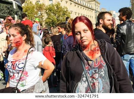 PARIS, FRANCE - OCTOBER 3, 2015: Two girls in zombie costume participating in Zombie parade at Place de la Republique. Zombie Walk is an annual event in Paris. - stock photo