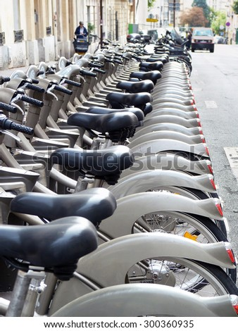 PARIS, FRANCE - October 2, 2014: Velib rental bikes have become a popular way for working people in Paris to get from home or transit hubs to their jobs and back.