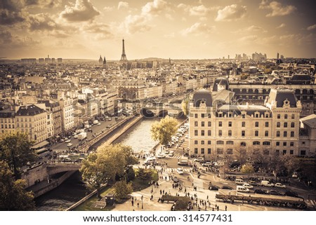 PARIS, FRANCE - OCTOBER 9, 2014:  View of Paris buildings from above seen at Notre Dame with vintage filter effect - stock photo