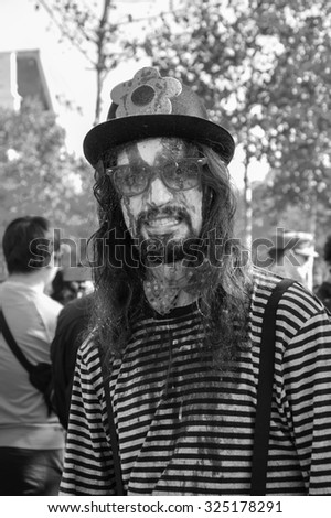 PARIS, FRANCE - OCTOBER 3, 2015: Young man in costume of zombie clown participating in Zombie parade at Place de la Republique. Zombie Walk is an annual event in Paris. - stock photo