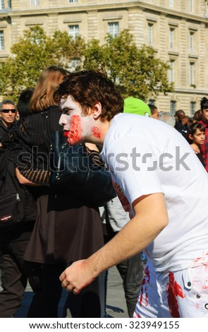 PARIS, FRANCE - OCTOBER 3, 2015: Young man in  zombie costume participating in Zombie parade at Place de la Republique. Zombie Walk is an annual event in Paris. - stock photo