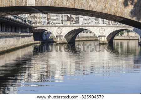 PARIS, FRANCE, on AUGUST 30, 2015. A view of Skyline on Seine Embankment and the bridge through the river - stock photo