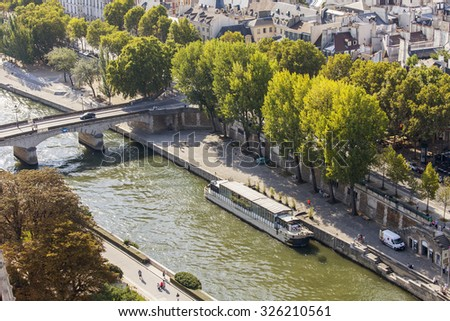 PARIS, FRANCE, on AUGUST 30, 2015. A view of the city from a survey platform on Notre-Dame de Paris. Eiffel Tower in the distance. This look is one of the most beautiful views of Paris from above