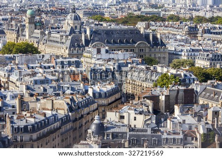 PARIS, FRANCE, on AUGUST 30, 2015. A view of the city from a survey platform on Notre-Dame de Paris. Eiffel Tower in the distance. This look is one of the most beautiful views of Paris from above - stock photo