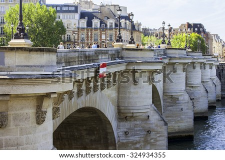 PARIS, FRANCE, on AUGUST 29, 2015. Novy Bridge (fr. Pont Neuf) - the oldest of the remained bridges of Paris through the river Seine