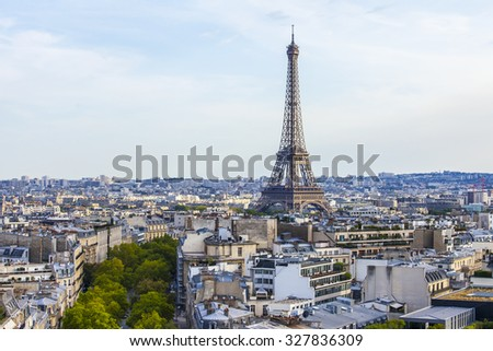 PARIS, FRANCE, on AUGUST 30, 2015. The top view from a survey platform on Arc de Triomphe on the Champs Elysee. Roofs of Paris and Eiffel Tower