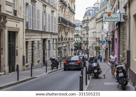 PARIS, FRANCE, on AUGUST 31, 2015. Urban view. Typical Parisian street in the bright sunny day.