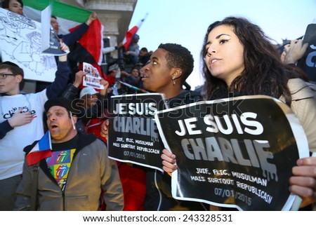 PARIS - France on 08 January 2015 : Peaceful protest in Place de la Republique against the terrorist attack on Charlie Hebdo journal, promoting freedom of speech  - stock photo
