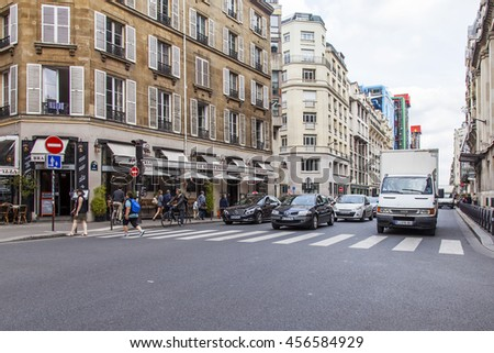 PARIS, FRANCE, on JULY 6, 2016. Brisk city intersection
