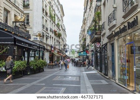 PARIS, FRANCE, on JULY 7, 2016. The typical city street with historical building.