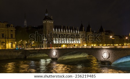 Paris, France, on May 3, 2013. Typical urban view at night. The walking ship floats across Seine