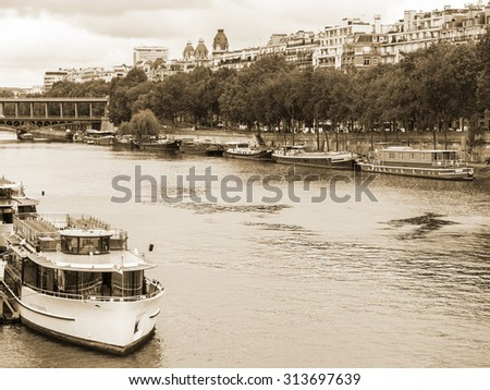 PARIS, FRANCE, on SEPTEMBER 1, 2015. A view of the embankments of Seine and the ships moored to the coast. Metro Bridge Bir Hakeim in the distance