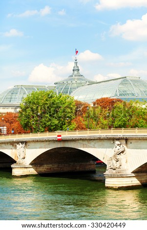 Paris, France. Pont des invalides in a sunny day. Grand Palais is visible in the background - stock photo