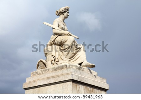 Paris, France - Seine Statue (Louis Petitot) on Pont du Carrousel (Carrousel Bridge) - stock photo