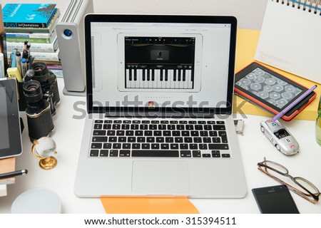 PARIS, FRANCE - SEP 10, 2015: Apple Computers website on MacBook Pro Retina in a creative room environment showcasing the newly announced iPad Pro with garage Band - stock photo