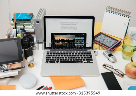 PARIS, FRANCE - SEP 10, 2015: Apple Computers website on MacBook Pro Retina in a creative room environment showcasing the newly announced iPad Pro and high perfomance apps - stock photo