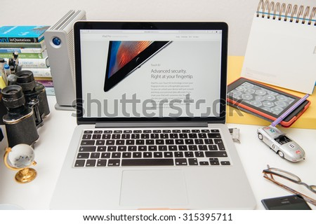 PARIS, FRANCE - SEP 10, 2015: Apple Computers website on MacBook Pro Retina in a creative room environment showcasing the newly announced iPad Pro with Touch ID - stock photo