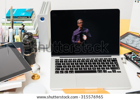 PARIS, FRANCE - SEP 10, 2015: Apple Computers website on MacBook Pro Retina in a creative room environment showcasing Apple Event with Tim Cook holding the new iPad - stock photo