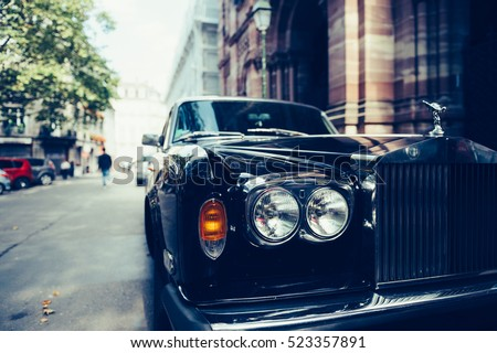 PARIS, FRANCE - SEP 12, 2016: Front view of Exclusive Luxury Rolls-Royce car limousine parked in city during fashion wedding vip event waiting for passenger.