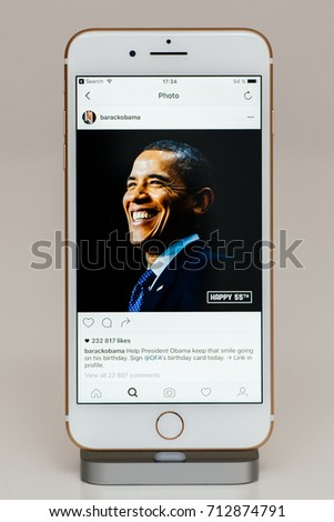 PARIS, FRANCE - SEP 26, 2016: New Apple iPhone 7 Plus in docking station after unboxing and testing by and app application software Barack Obama 55th anniversary photos on Instagram official account