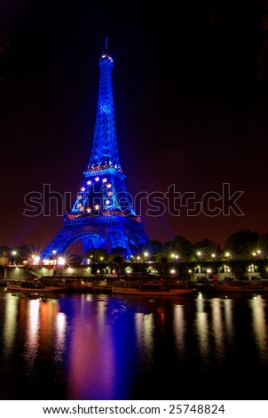 PARIS, FRANCE, 27 SEPT. 2008: from July to December 2008 the Eiffel tower in Paris is illuminated in blue color to celebrate French EU presidency. - stock photo