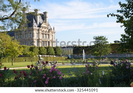 PARIS, FRANCE - SEPT 9, 2014: Paris -  Local and Tourist in famous Tuileries garden. Tuileries Garden  is a public garden located between the Louvre Museum and the Place de la Concorde. France.