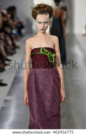 PARIS, FRANCE - SEPTEMBER 30: A model walks the runway during the Maison Margiela show as part of the Paris Fashion Week Womenswear Spring/Summer 2016 on September 30, 2015 in Paris, France. - stock photo